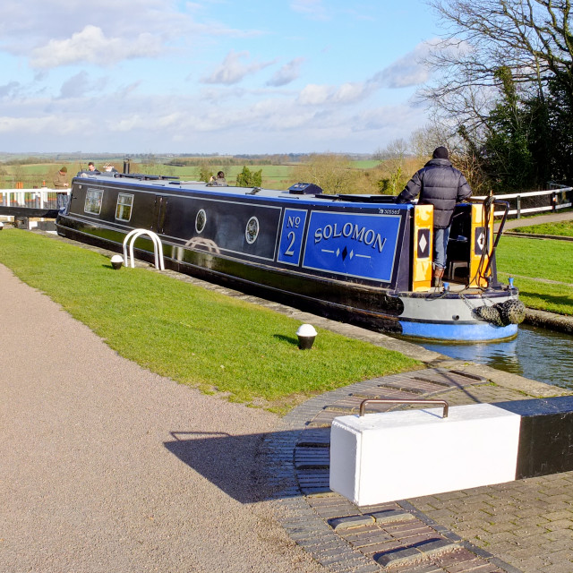 """A narrowboat in a canal lock"" stock image"