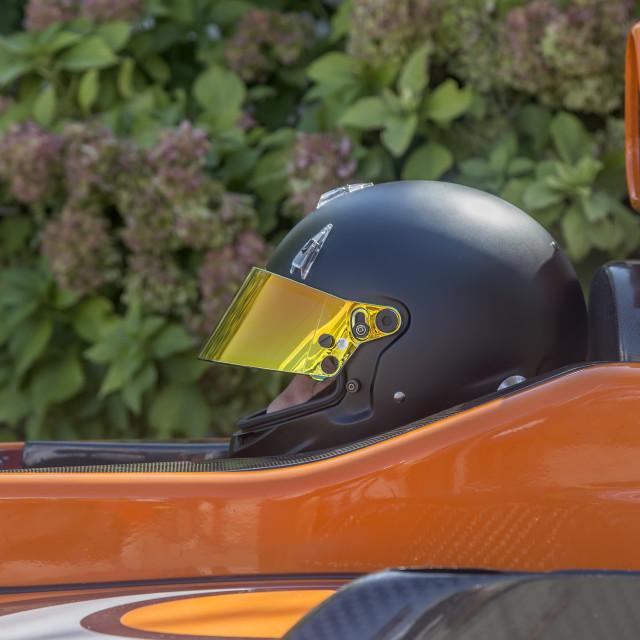 """Driver in black helmet"" stock image"