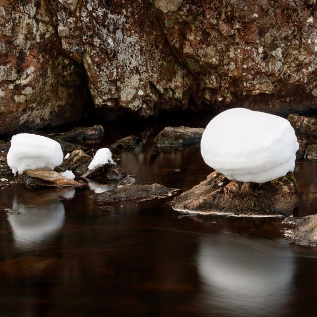 """Snow capped rocks"" stock image"
