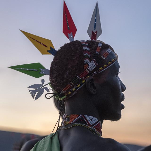 """Portrait Samburu tribal members wearing traditional head peice at dusk, Kenya."" stock image"