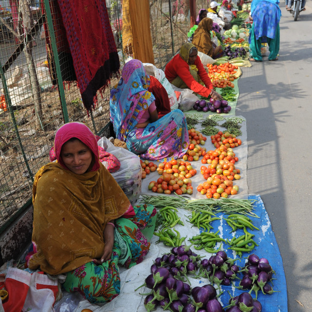 """""""Women at village street market selling home grown vegetables laid out on..."""" stock image"""