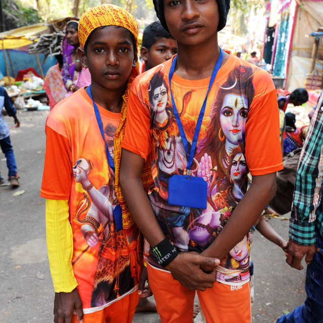 """""""Two young pilgrims, in orange T shirts with images of Lord Shiva, going to..."""" stock image"""
