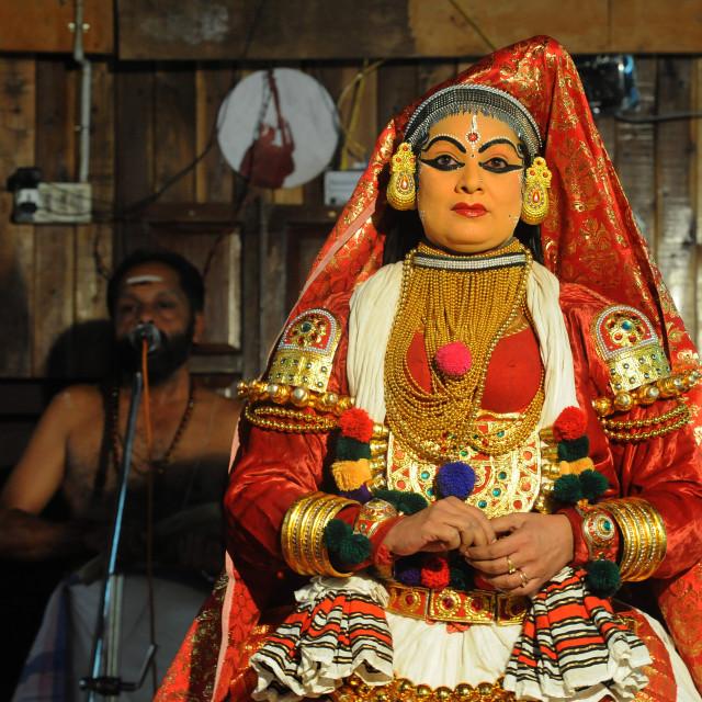 """Contemporary female performer in a Kathakali dance depicting folk mythologies..."" stock image"