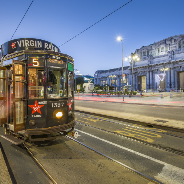 """""""City tram outside of Milan Central Station at dusk, Milan, Lombardy, Italy,..."""" stock image"""