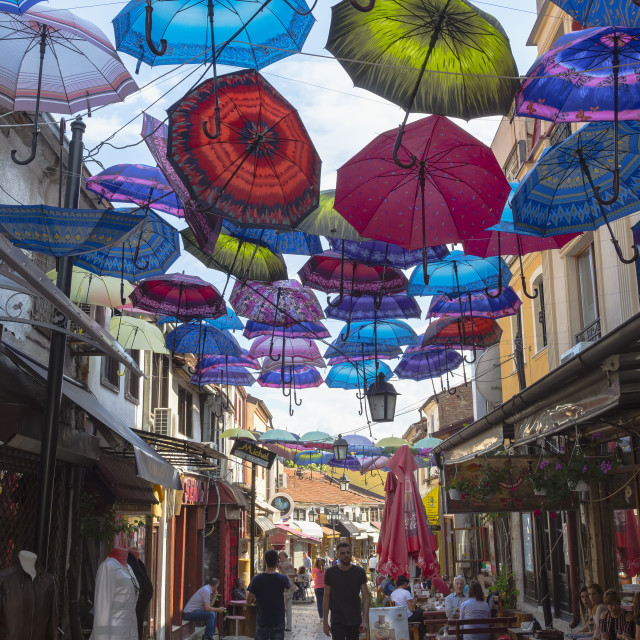 """Colorful umbrellas hanging in a street, Skopje, Macedonia"" stock image"
