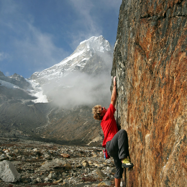 """Climber bouldering at Tangnag moraine, Khumbu"" stock image"
