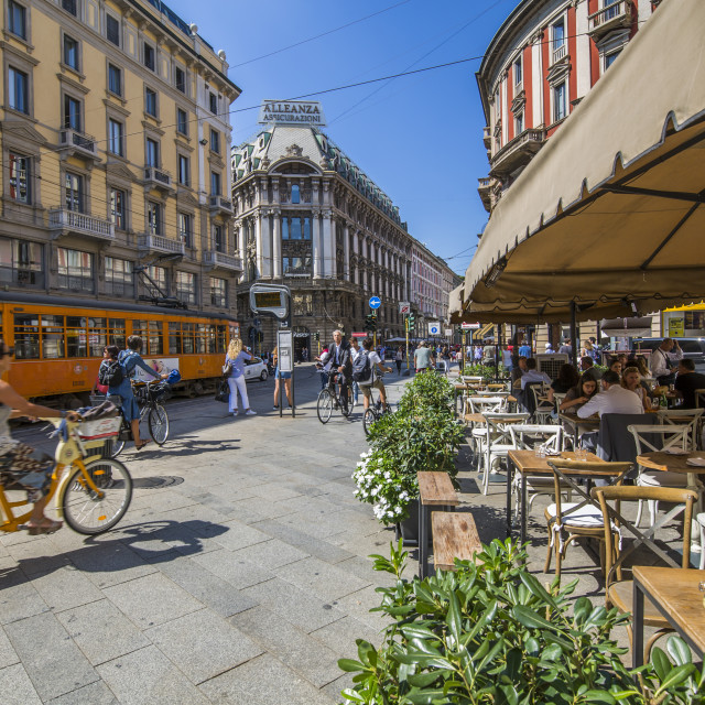 """View of restaurant, tram and pedestrians on Via Dante, Milan, Lombardy,..."" stock image"