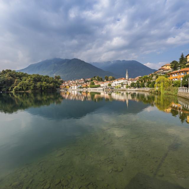 """View of Mergozzo reflecting in Lake Mergozo, Piedmont, Italy, Europe"" stock image"