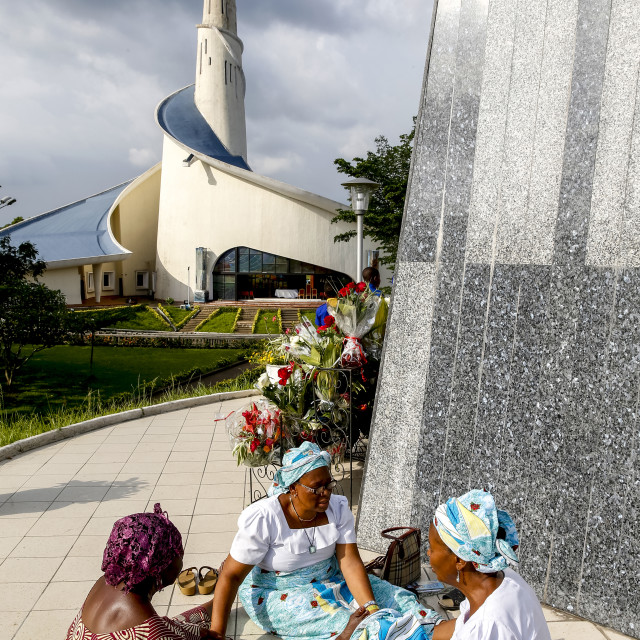 """""""Pilgrims praying and joining hands at Our Lady of Africa catholic sanctuary,..."""" stock image"""
