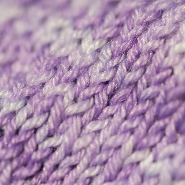 """""""Fragment of seamless knitted patterns with range of purple colors. Realistic knitted texture for the background of the site, nvitations, wallpapers"""" stock image"""