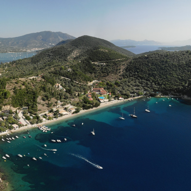 """""""Desimi Beach Golf and nearby Island with clear water in Greece."""" stock image"""