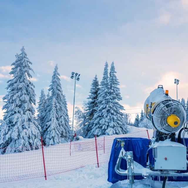 """Ski resort with snow gun making new surface."" stock image"