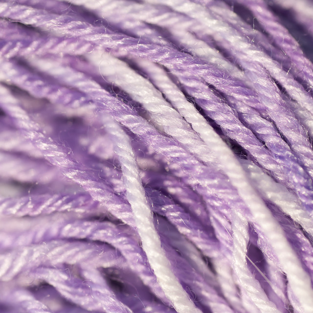 """Skein of mix violet purple melange knitting thread close up"" stock image"