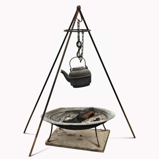 """""""Dutch oven cast iron kettle and rod tripod over firewood metal pan."""" stock image"""