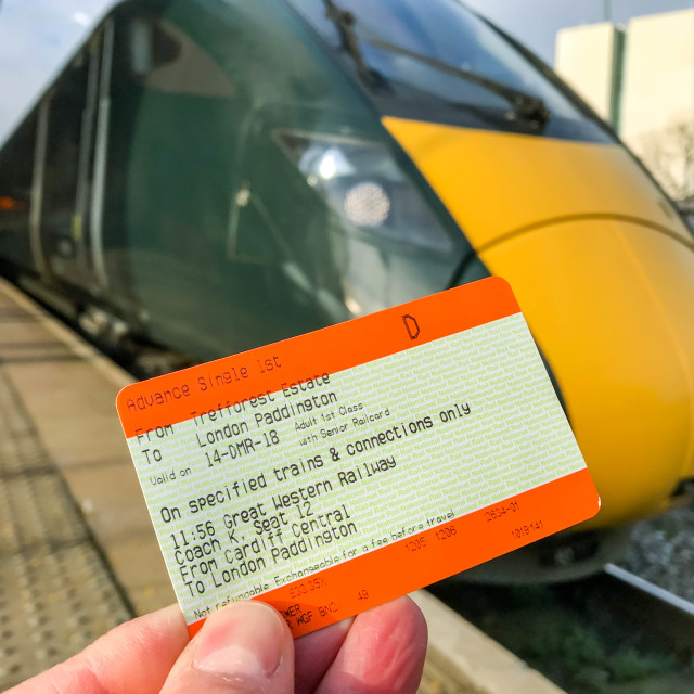 """Rail ticket with an inter city express train in the background"" stock image"
