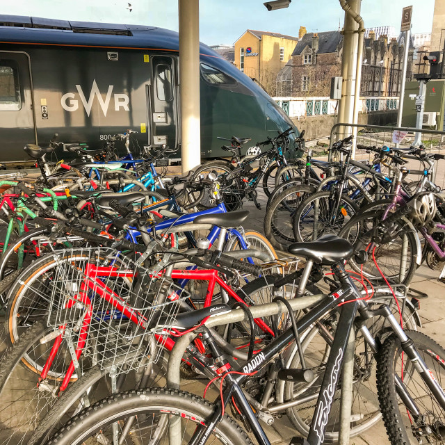"""Commuters' bicycles secured to bike racks at Cardiff Central station"" stock image"