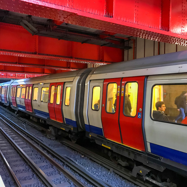 """London Underground train stopped at a station platform"" stock image"