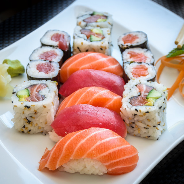 """Sushi maki and California Roll with ginger and wasabi on a plate with chopsticks"" stock image"