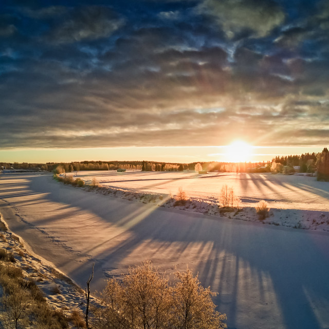"""""""Sun Rising Over The Frozen River"""" stock image"""