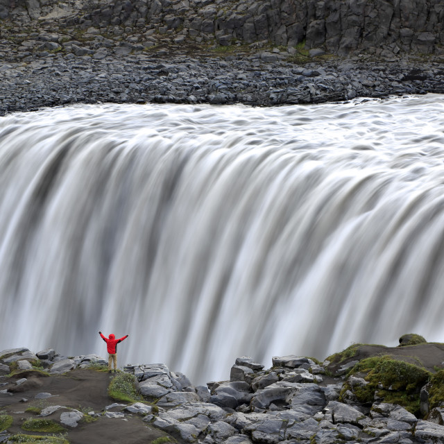 """Hiker on rim of Dettifoss Waterfalls, near Reykjahlid, Iceland"" stock image"