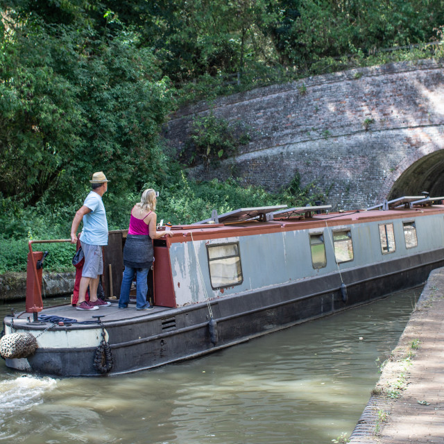 """""""Narrowboat entering Blisworth Tunnel on the Grand Union Canal"""" stock image"""