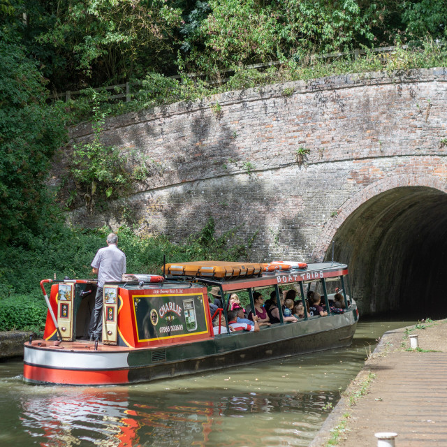 """Canal Boat Entering Braunston Tunnel on the Grand Union"" stock image"