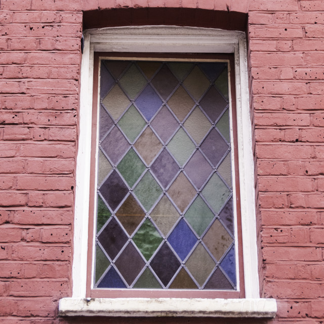 """""""stained glass window in pink brick wall"""" stock image"""