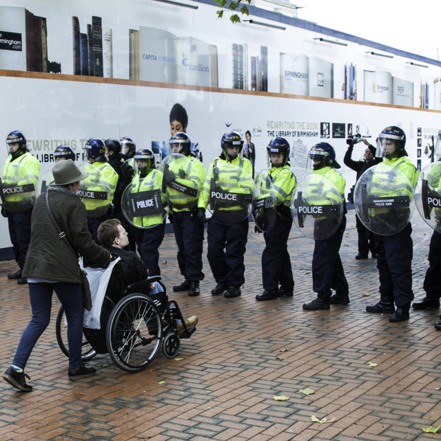 """""""Wheel Chair and Riot Police"""" stock image"""