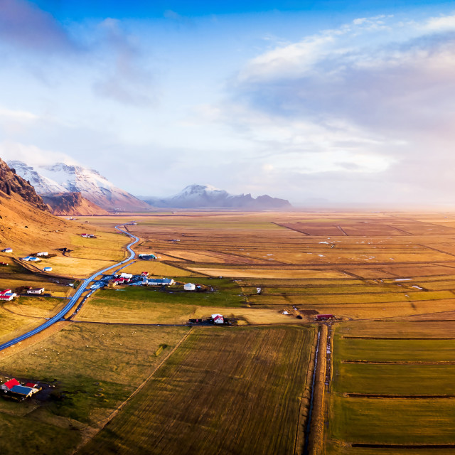 """Village and scenic road in Iceland aerial panoramic view"" stock image"