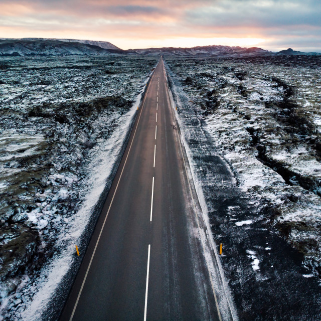 """Road in Iceland surrounded by lava fields covered with snow"" stock image"