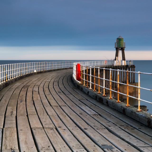 """""""Whitby pier sunrise"""" stock image"""