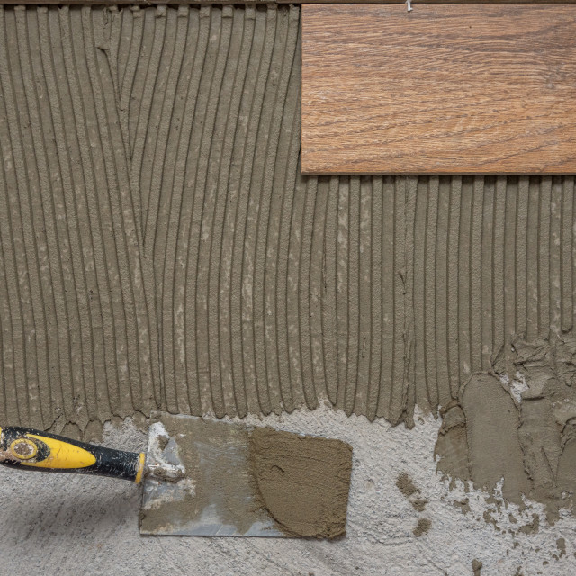 """""""Ceramic tiles and tools for tiler. Floor tiles installation."""" stock image"""