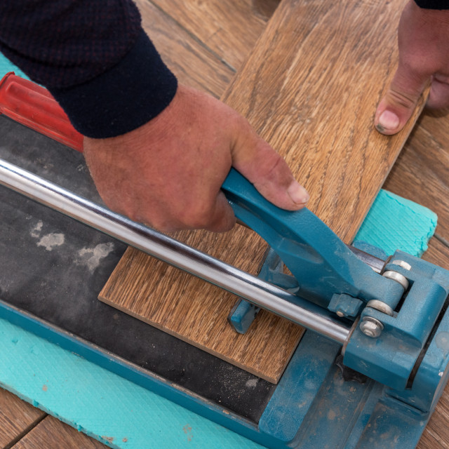 """Cutting Ceramic Tiles."" stock image"