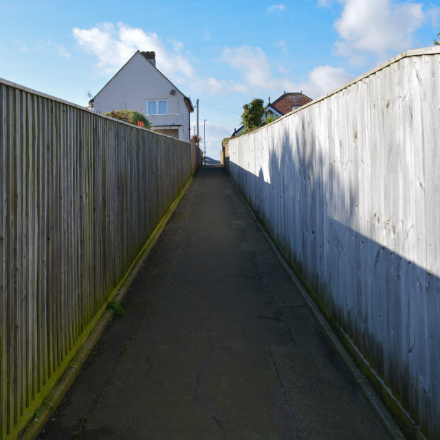 """Narrow Path to Houses"" stock image"
