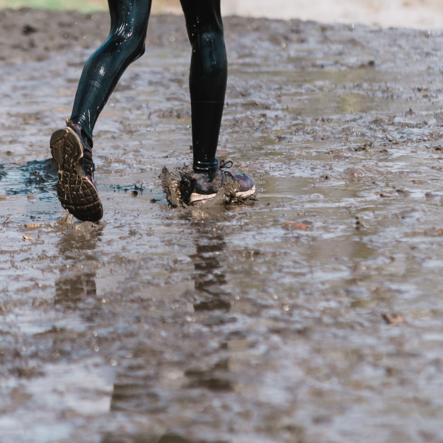 """""""training on bad weather. Running in rain, close up on shoes"""" stock image"""
