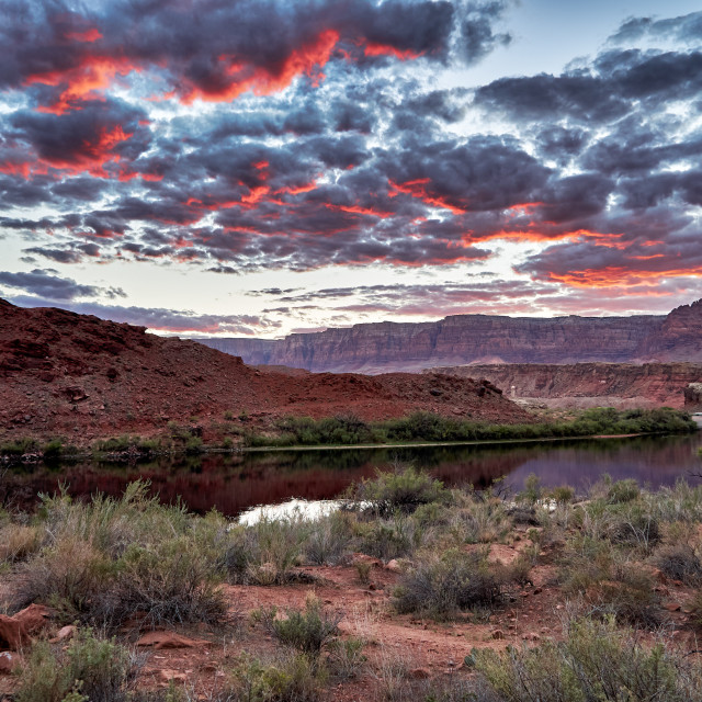 """""""sunset is glowing in clouds over Colorado river and Vermillion Cliffs"""" stock image"""