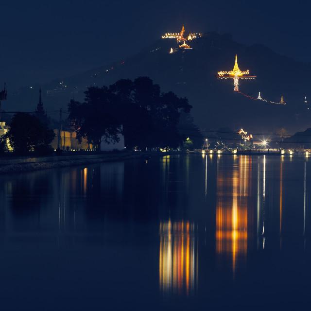 """""""Palace moat and Mandalay Hill at night, Mandalay, Myanmar. The Su Taung Pyae..."""" stock image"""