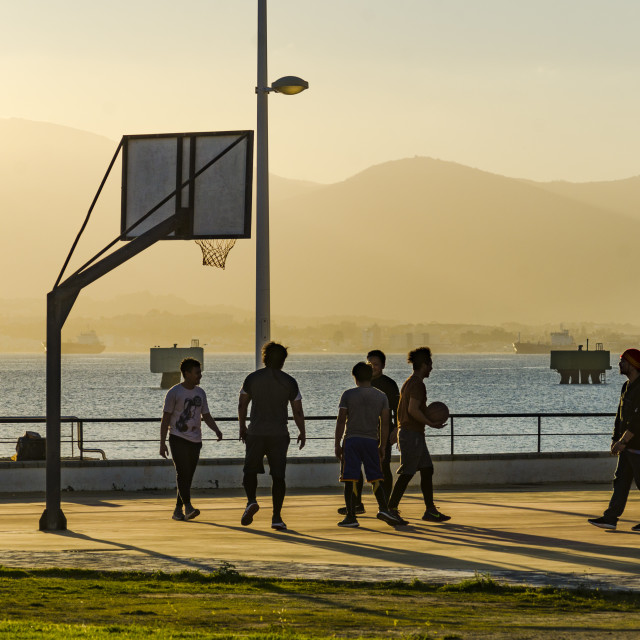 """""""Group of teenagers playing basketball on playground court"""" stock image"""
