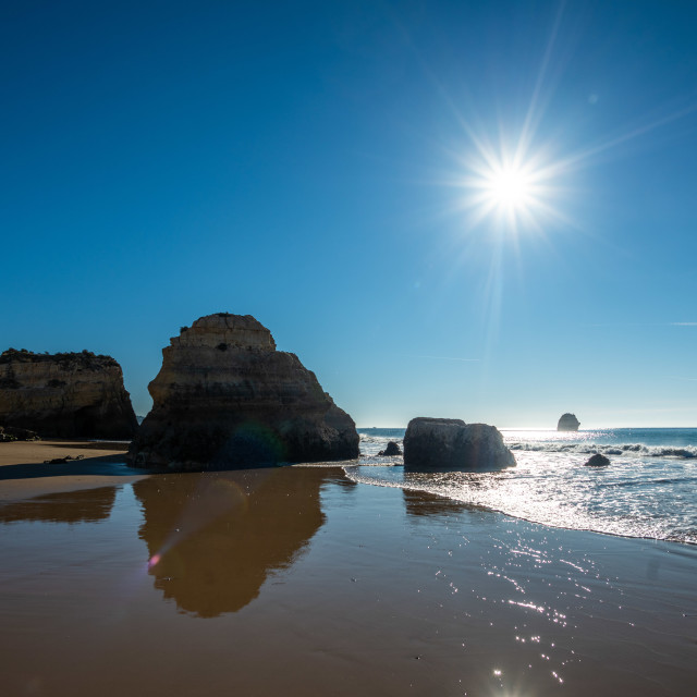 """Sun Over Praia Da Rocha Beach"" stock image"