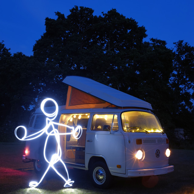 """""""A child like light painted figure and a retro camper van"""" stock image"""