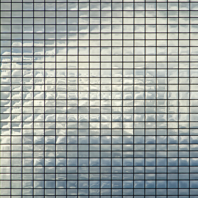 """Clouds reflecting in office facade"" stock image"