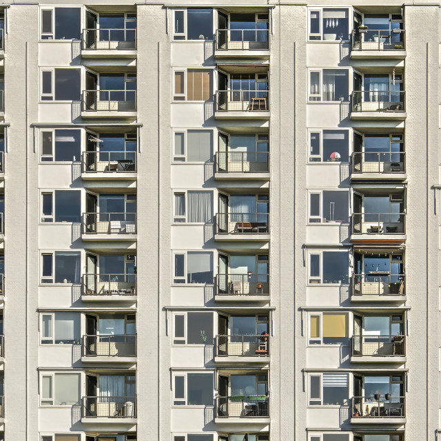 """Residential facade with windows and balconies"" stock image"