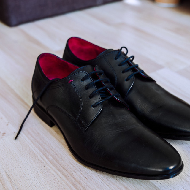 """""""black men's leather shoes on the floor"""" stock image"""