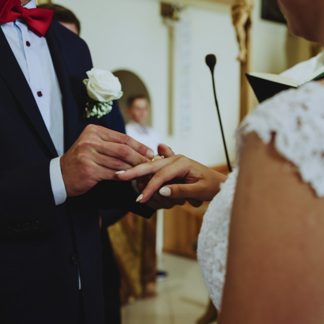 """""""wedding at the church, close-up of donning wedding rings"""" stock image"""