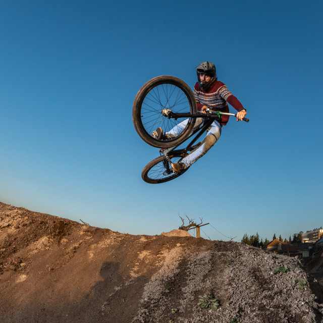 """MTB Bike jump over a dirt trail"" stock image"
