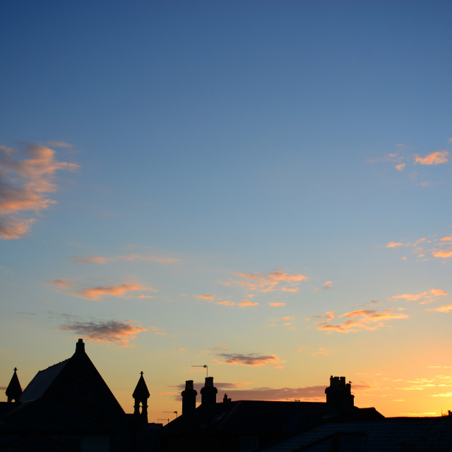 """Dawn Sunrise Over Rooftops"" stock image"