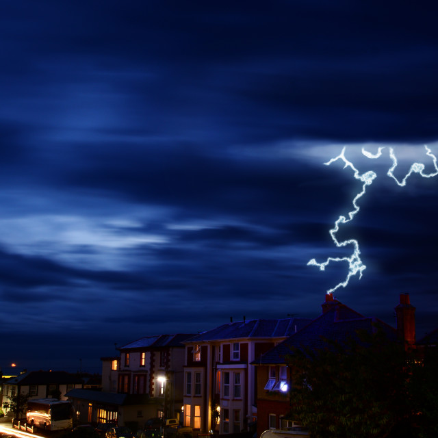 """Lightning Striking Town Houses"" stock image"