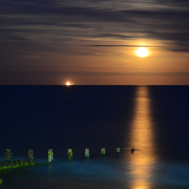 """Full Moon Rising Over Sandown Bay"" stock image"
