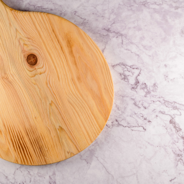 """""""Wooden cutting board on a gray marble background"""" stock image"""