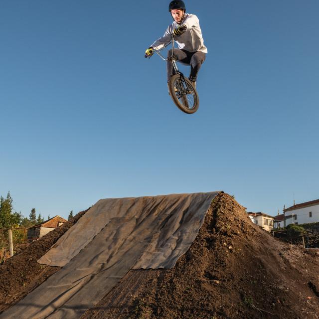 """BMX Bike jump over a dirt trail"" stock image"